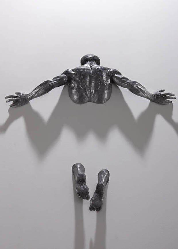 Figurative Sculptures Embedded In Gallery Walls by Matteo Pugliese.
