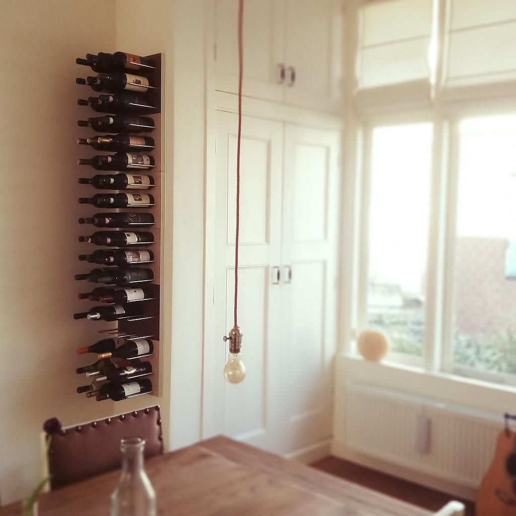 STACT modular wine wall rack.