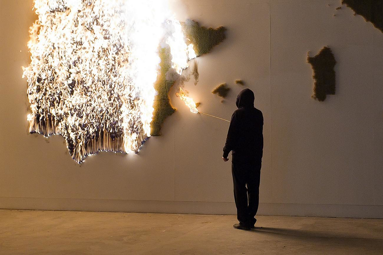 P.I.G.S. A Burning Art Installation by Claire Fontaine.